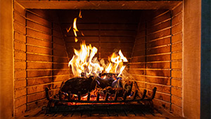 A fire in a fireplace is dangerous and causes house fires