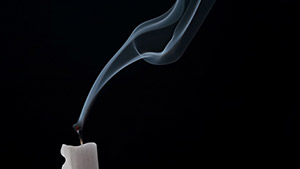 A candle which can cause soot damage